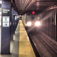 Photo taken at MTA Subway - Delancey St/Essex St (F/J/M/Z) by chuckdafonk F. on 4/20/2012
