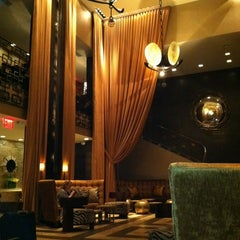 Photo taken at The Empire Hotel Lobby Bar by CJ J. on 3/20/2012