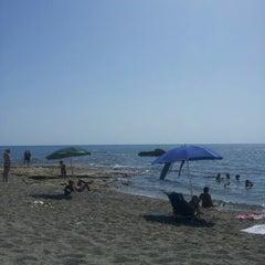 Photo taken at Spiaggia allo Scoglio by Arianna F. on 7/15/2012