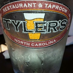 Photo taken at Tyler's Restaurant & Taproom by Emily C. on 6/16/2012