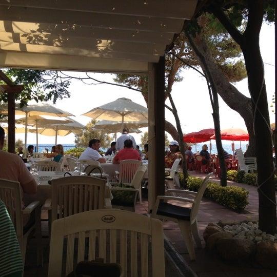 Photo taken at Cala Canyelles by Naira on 7/20/2012