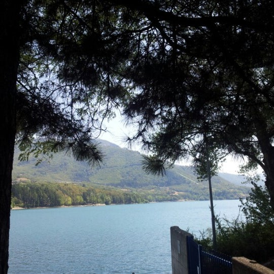 Photo taken at Lago di Suviana by Gabriele D. on 8/15/2012