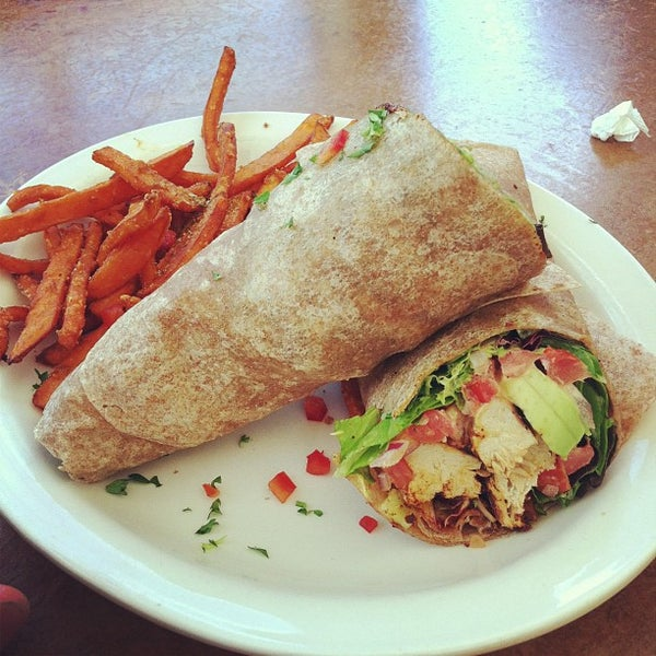 Photo taken at Native Foods Café by Alex S. on 10/12/2012