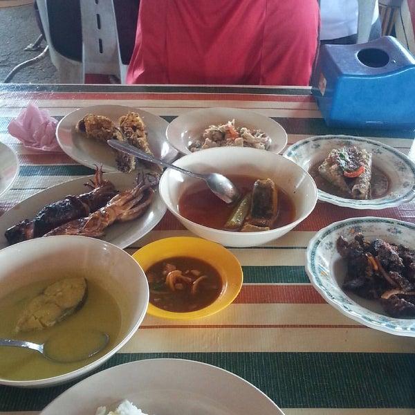 Photo taken at Tanjung Dawai by Muzaidi K. on 8/7/2016