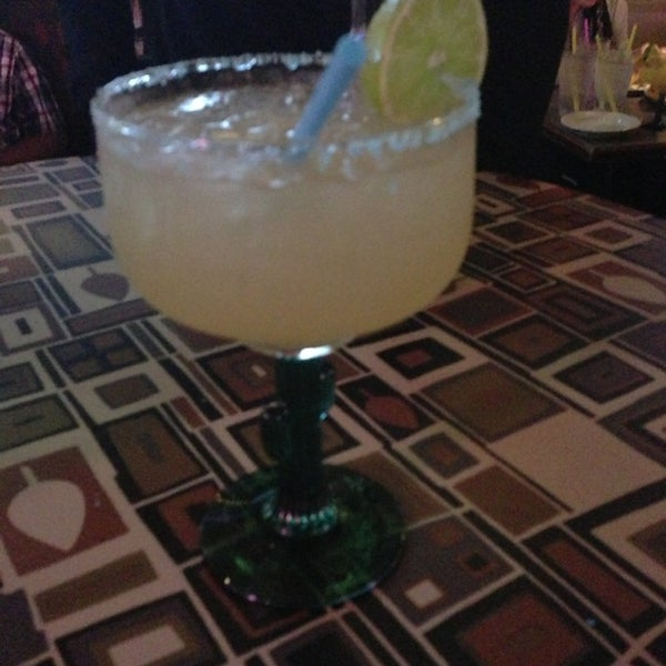 Photo taken at Sunset Cantina by J B. on 4/8/2013