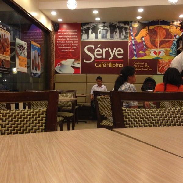 Photo taken at Sérye Café Filipino by Sherica O. on 6/23/2013