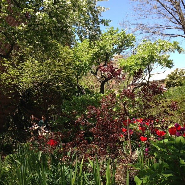 Photo taken at The Garden at St. Luke in the Fields by betsy m. on 5/1/2013