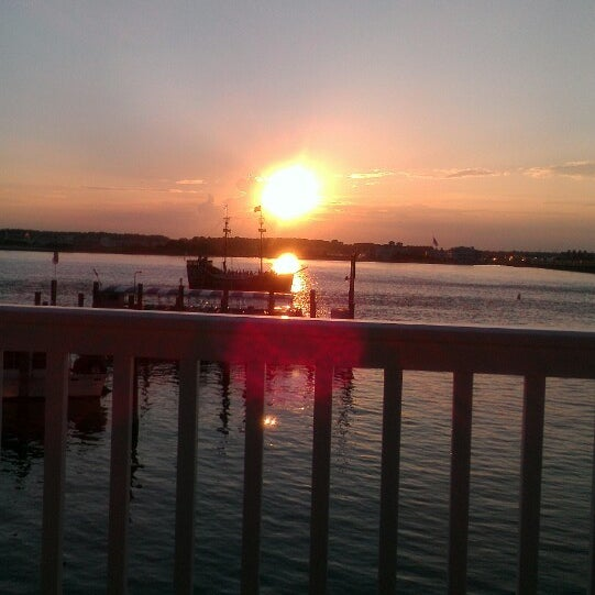 Photo taken at Marina Deck Resturant by Renee V. on 8/22/2013