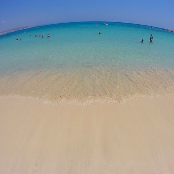 Photo taken at Makronissos beach by Anna I. on 7/20/2016
