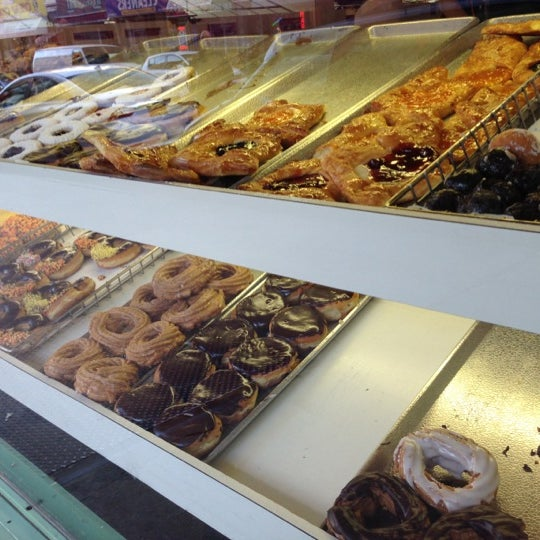 Photo taken at Peter Pan Donut & Pastry Shop by brittany j. on 11/21/2012