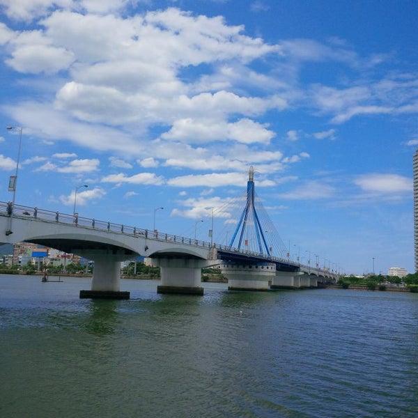 Photo taken at Cầu Sông Hàn (Han River Bridge) by Kota N. on 8/9/2014