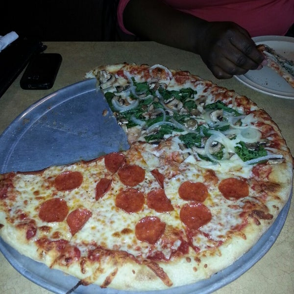 Photo taken at Stone Mountain Pizza Cafe by Keith M. on 10/4/2013