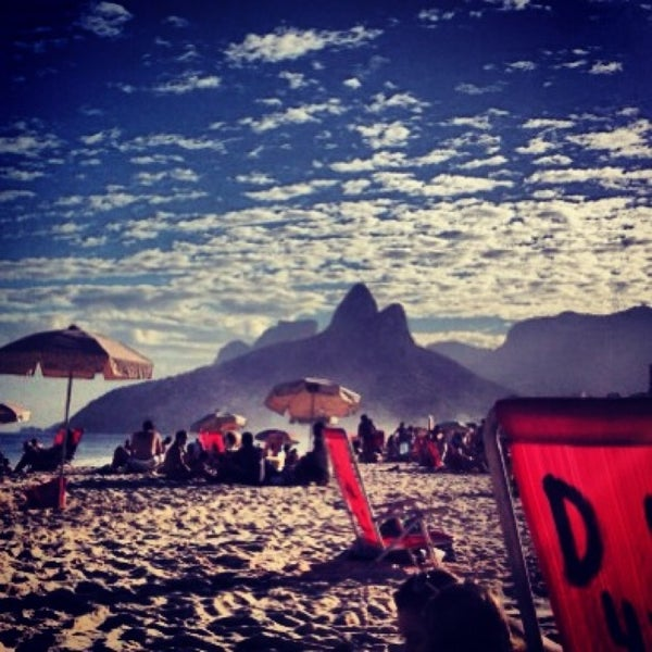 Photo taken at Praia de Ipanema by Bruna M. on 7/13/2013