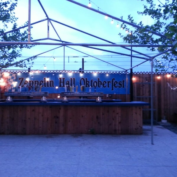 Photo taken at Zeppelin Hall Biergarten by Konrad S. on 5/11/2013