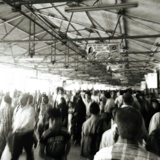 Photo taken at Dadar Railway Station by Schmmuck on 1/26/2013