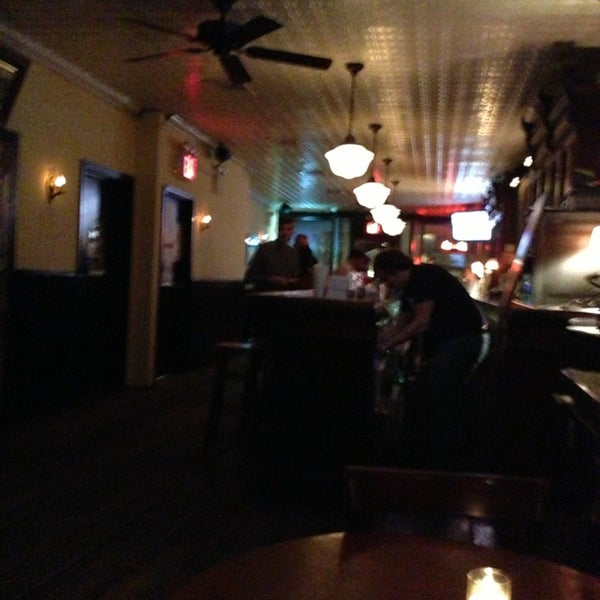 Photo taken at 11th Street Bar by Will N. on 1/30/2013