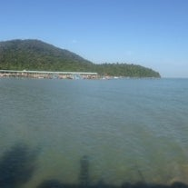 Photo taken at Teluk Bahang Beach by Dave R. on 12/23/2013