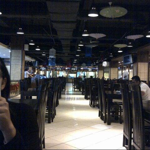 Photo taken at Pusat Grosir Jembatan Merah Plasa (JMP) by Sari on 2/2/2013