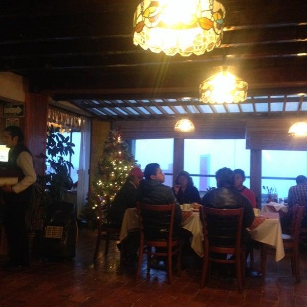 Photo taken at Villa Alpina El Chalet by Aida R. on 1/2/2014