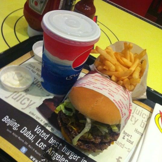 Photo taken at Fatburger | فات برجر by aldawood . on 10/1/2012