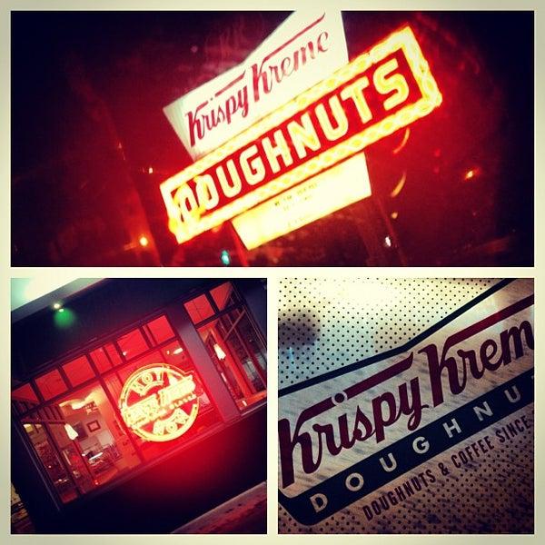 Photo taken at Krispy Kreme Doughnuts by Ryan K. on 12/29/2012