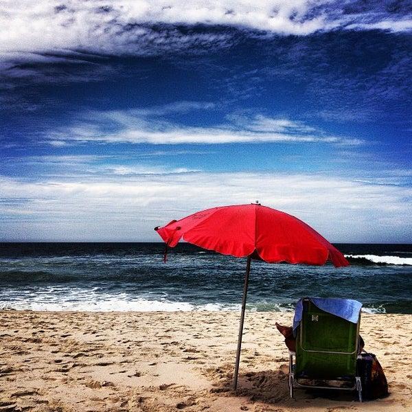 Photo taken at Praia da Barra da Tijuca by Beta B. on 3/10/2013