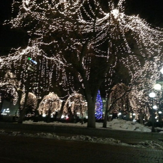 Photo taken at Rice Park by Leslie T. on 12/20/2012