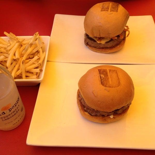 Photo taken at Umami Burger by Be L. on 7/24/2013
