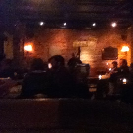 Photo taken at 11th Street Bar by Tom D. on 11/13/2012