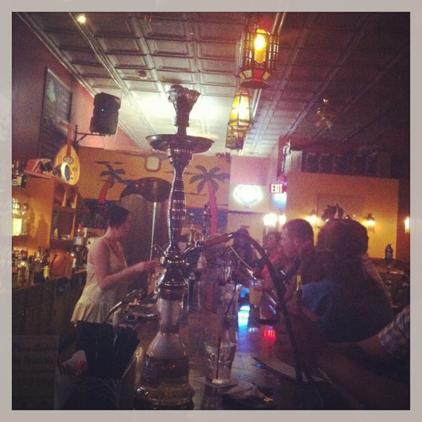 Photo taken at Nara Cafe Hookah Bar by Juliana on 4/15/2013