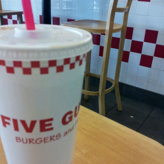 Photo taken at Five Guys by Sean M. on 4/12/2013