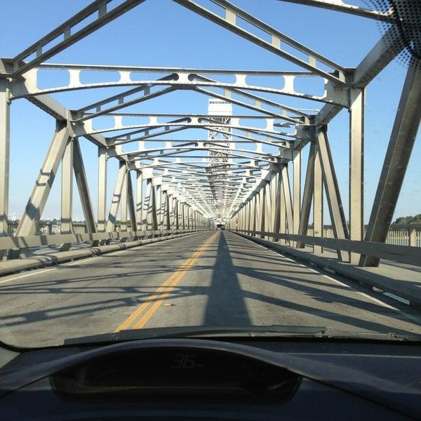 Photo taken at Rio Vista Bridge by Caro G. on 8/10/2013