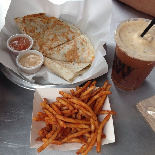 Photo taken at Army Navy Burger + Burrito by Aisha D. on 8/31/2013
