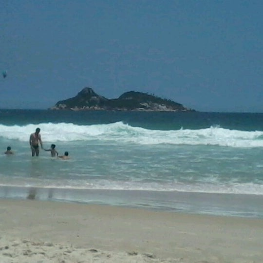 Photo taken at Praia da Barra da Tijuca by Daiane S. on 12/24/2012