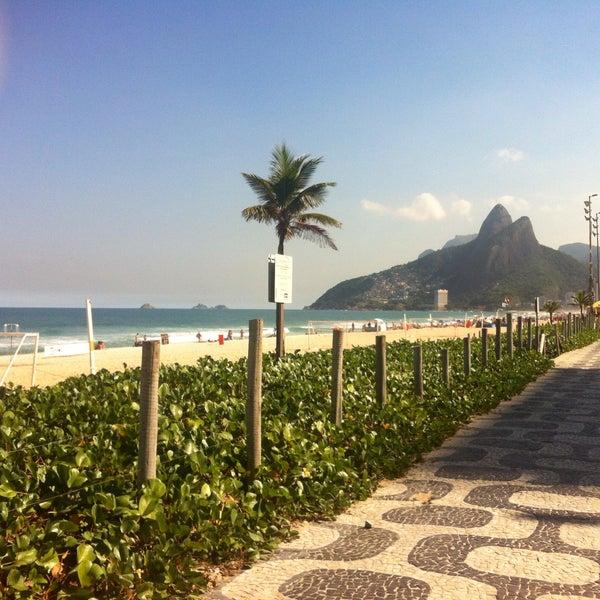 Photo taken at Praia de Ipanema by Nadja H. on 5/20/2013