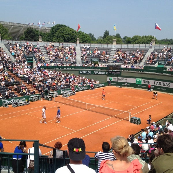 Photo taken at Stade Roland Garros by Thomas M. on 6/8/2013