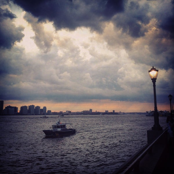 Photo taken at Battery Park City Esplanade by Eugene K. on 7/21/2015