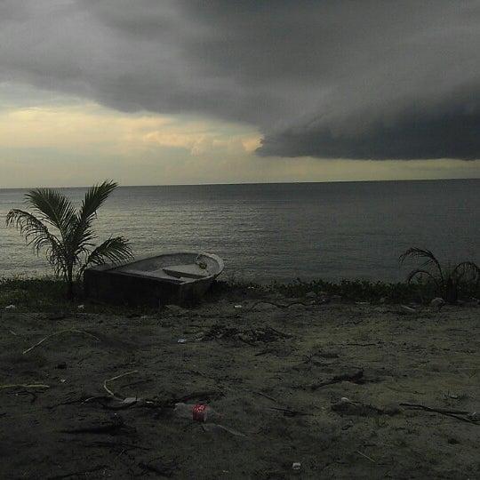 Photo taken at Teluk Bahang Beach by SaSa S. on 3/3/2013