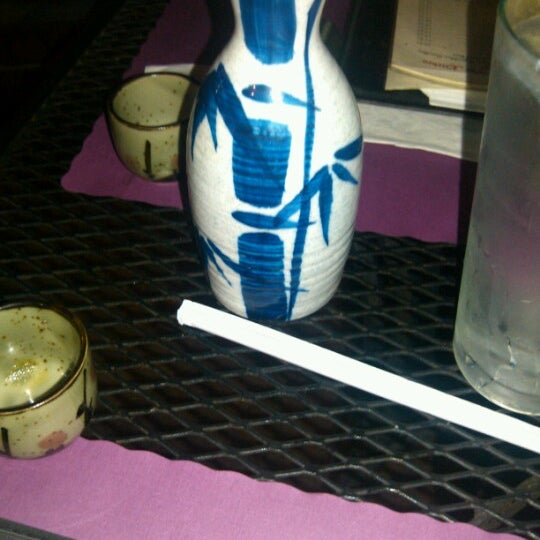 Photo taken at Sushi Cafe by Gregory D. on 12/1/2012