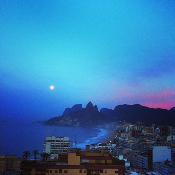 Photo taken at Praia de Ipanema by Abeel O. on 4/26/2013
