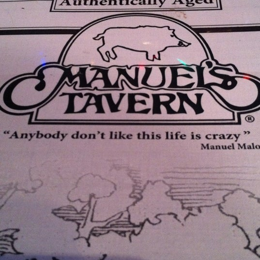 Photo taken at Manuel's Tavern by Robert J. on 12/13/2012