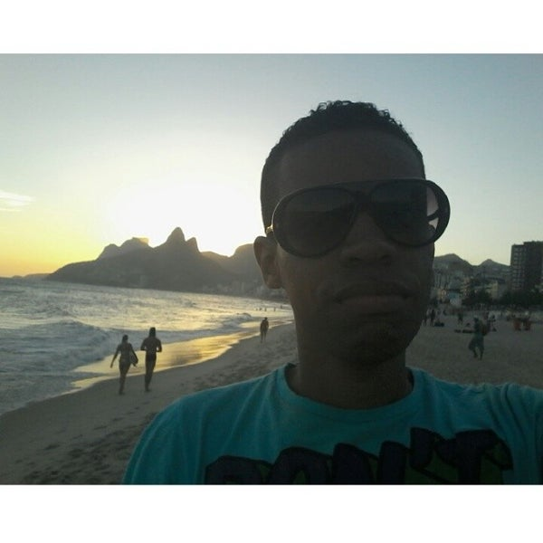Photo taken at Praia de Ipanema by Guilherme M. on 3/15/2014
