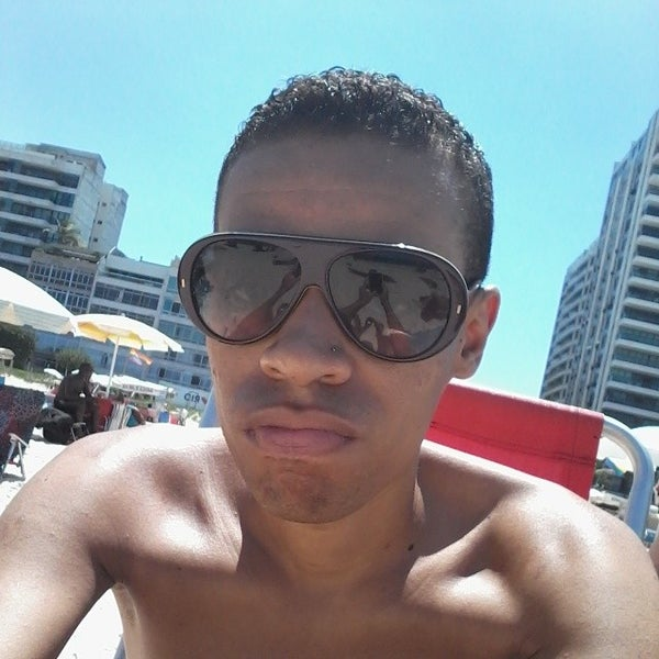 Photo taken at Praia de Ipanema by Guilherme M. on 3/14/2014