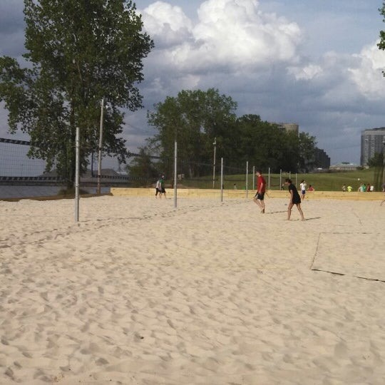 Photo taken at Whiskey Island Volleyball Courts by Morgan W. on 5/21/2013