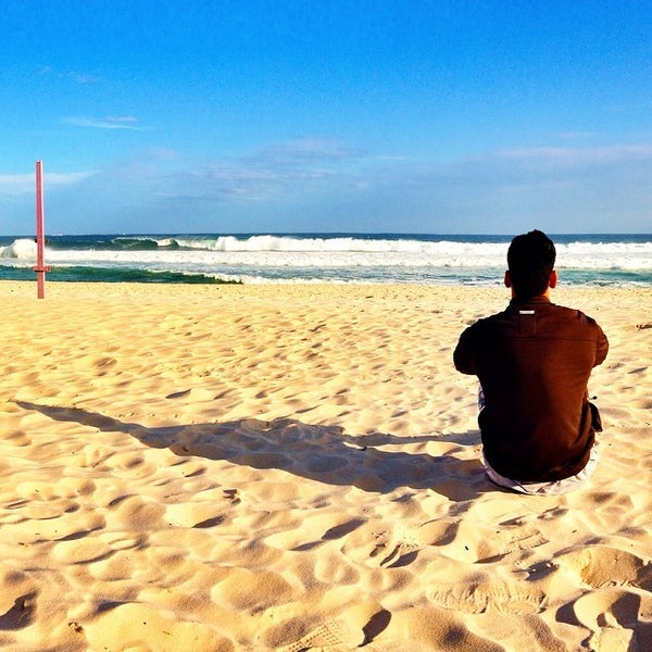 Photo taken at Praia da Barra da Tijuca by Douglas E. on 8/17/2014