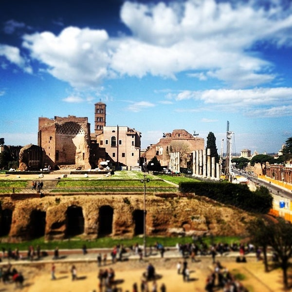 Photo taken at Piazza del Colosseo by Alex C. on 3/8/2014