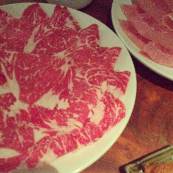 Photo taken at Shabu-Tatsu by Stephanie C. on 12/27/2012