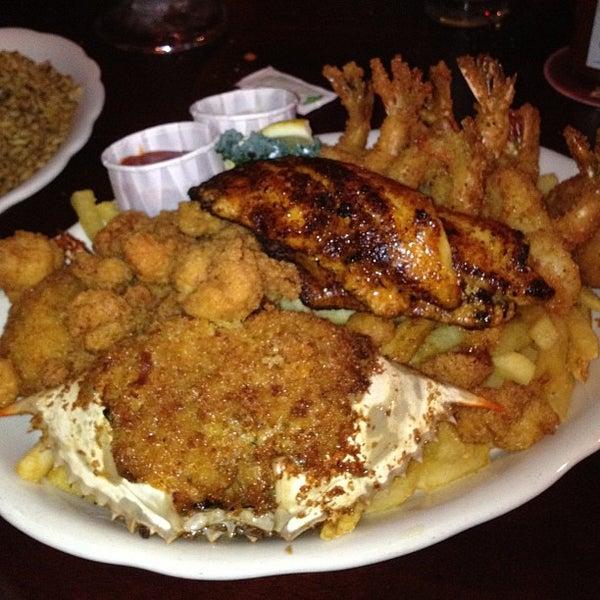 Photo taken at Pappadeaux Seafood Kitchen by Tim L. on 3/7/2013