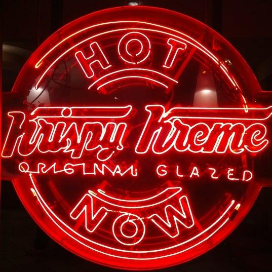 Photo taken at Krispy Kreme Doughnuts by Kevin S. on 12/13/2012