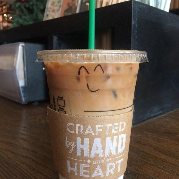 Photo taken at Starbucks by Tikamporn L. on 12/1/2016